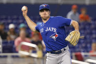 Toronto Blue Jays starting pitcher Ross Stripling throws to first base after catching a ball during the first inning of a baseball game against the Miami Marlins, Tuesday, June 22, 2021, in Miami. (AP Photo/Marta Lavandier)