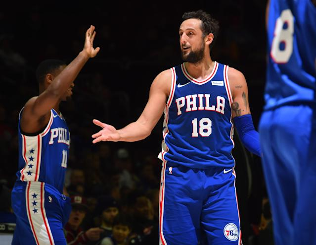 PHILADELPHIA,PA - MARCH 21 : Marco Belinelli #18 of the Philadelphia 76ers gives hand shakes against the Memphis Grizzlies at Wells Fargo Center on March 21, 2018 in Philadelphia, Pennsylvania (Photo by Jesse D. Garrabrant/NBAE via Getty Images)