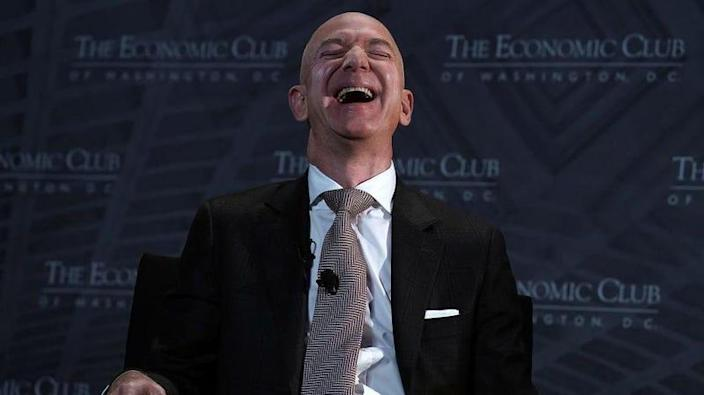 Jeff Bezos, laughing at the absurdity of such a question because of course he could.