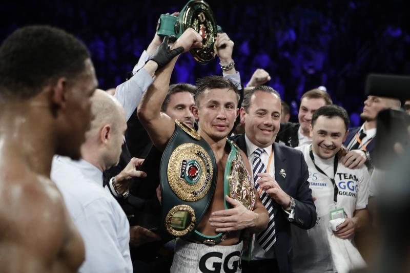 Gennady Golovkin, of Kazakhstan, celebrates after winning a middleweight boxing match against Daniel Jacobs, left, ealry Sunday, March 19, 2017, in New York. (AP Photo/Frank Franklin II)