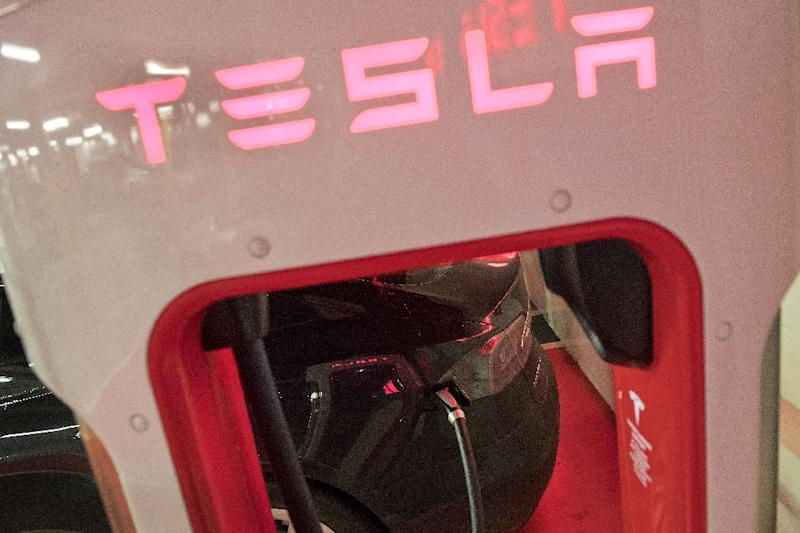 Shares of Tesla declined following the surprise replacement of its chief financial officer