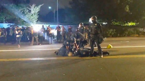 PHOTO: Portland police officers were video recorded on Aug. 30, 2020, repeatedly punching a protester being held down on a street. (Laura Jedeed/Twitter)
