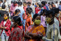 People, belonging to scheduled caste, scheduled tribe and other backward classes stand in queue to claim their rights at a certification camp by the backward classes welfare department in Kolkata, India, Sunday, Nov. 22, 2020. India's total number of coronavirus cases since the pandemic began has crossed 9 million. (AP Photo/Bikas Das)