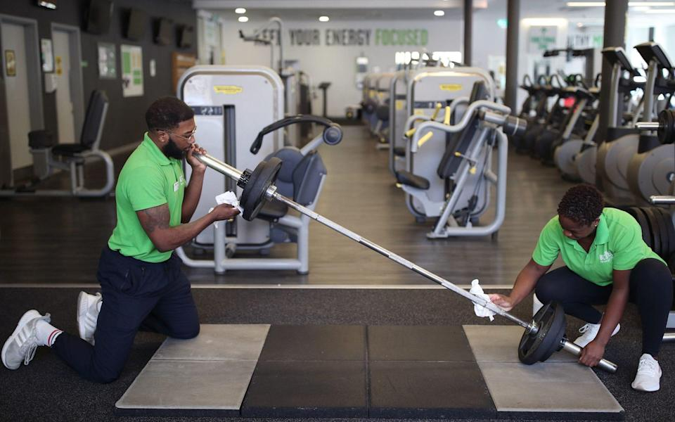 Staff members at Clapham Leisure Centre, south London, ready the gym facilities, as they prepare for reopening on April 12 - Yui Mok/PA
