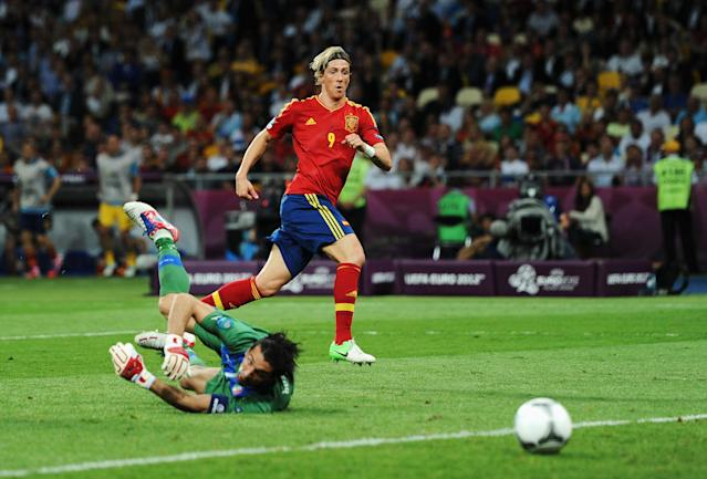 KIEV, UKRAINE - JULY 01: Fernando Torres of Spain scores his side's third goal past Gianluigi Buffon of Italy during the UEFA EURO 2012 final match between Spain and Italy at the Olympic Stadium on July 1, 2012 in Kiev, Ukraine. (Photo by Jasper Juinen/Getty Images)