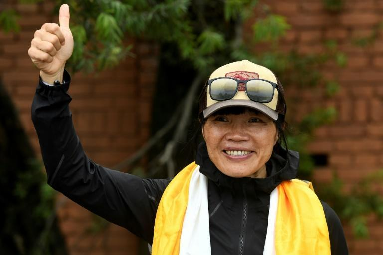 Former Hong Kong schoolteacher Tsang Yin-hung set a new record for the fastest ascent of Mount Everest by a woman in 25 hours and 50 minutes