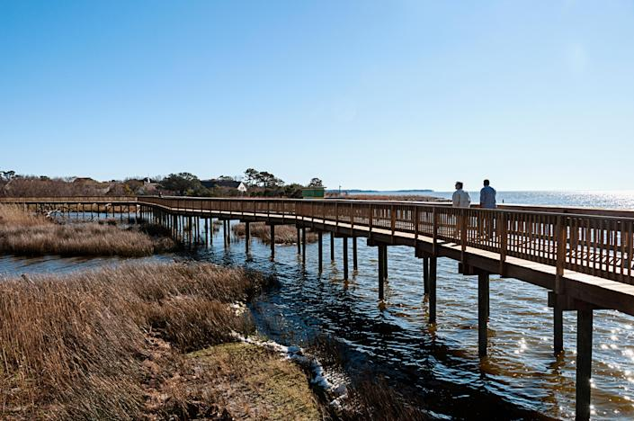 """Straddled by the Currituck Sound to the west and the Atlantic to the east, the quaint town of Duck—the youngest beach town of the <a href=""""https://www.cntraveler.com/story/where-to-eat-play-and-stay-in-the-outer-banks-north-carolina?mbid=synd_yahoo_rss"""" rel=""""nofollow noopener"""" target=""""_blank"""" data-ylk=""""slk:Outer Banks"""" class=""""link rapid-noclick-resp"""">Outer Banks</a>—offers a number of water activities for visitors of all ages. (Shell hunting, too, is a major pastime here.) Also not to be missed is the nationally-known Duck Jazz Festival, held every October."""