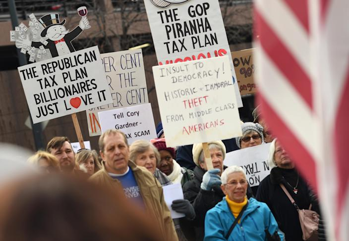 <p>Around a hundred people protested, outside U.S. Sen. Cory Gardner's Denver office, against a tax bill in the U.S. Senate on Nov. 28, 2017 in Denver, Colo. (Photo: R.J. Sangosti/The Denver Post via Getty Images) </p>