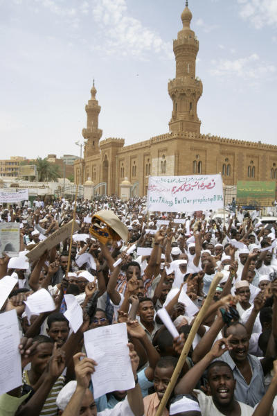 Sudanese protesters chant slogans in Khartoum, Sudan, Friday, Sept. 14, 2012, as part of widespread anger across the Muslim world about a film ridiculing Islam's Prophet Muhammad. Germany's Foreign Minister says the country's embassy in the Sudanese capital of Khartoum has been stormed by protesters and set partially on fire. Minister Guido Westerwelle told reporters that the demonstrators are apparently protesting against an anti-Islam film produced in the United States that denigrates the Prophet Muhammad.(AP Photo/Abd Raouf)