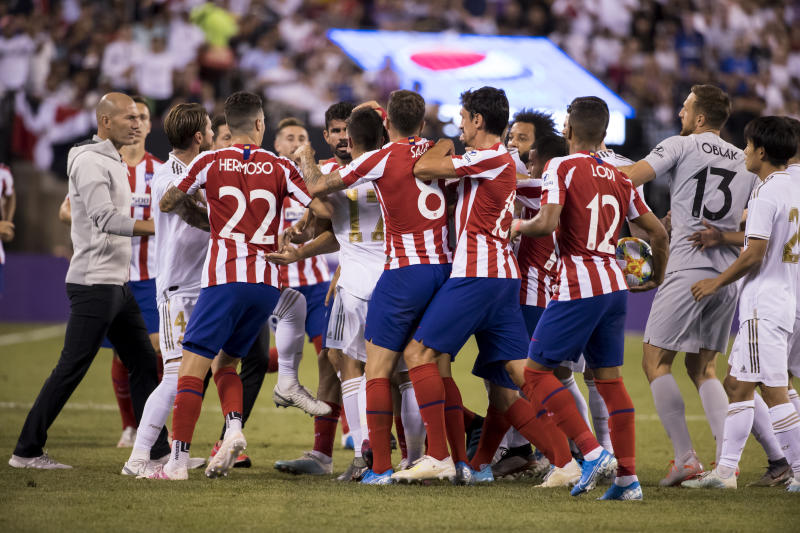 EAST RUTHERFORD, NJ - JULY 26: Head Coach Zinedine Zidane of Real Madrid tries to help players from Atletico de Madrid and Real Madrid try to stop Daniel Carvajal #2 of Real Madrid and Diego Costa #19 of Atletico Madrid from getting into a fight during the International Champions Cup Friendly match between Atletico de Madrid and Real Madrid. The match was held at MetLife Stadium on July 26, 2019 in East Rutherford, NJ USA. Atletico de Madrid won the match with a score of 7 to 3. (Photo by Ira L. Black/Corbis via Getty Images)