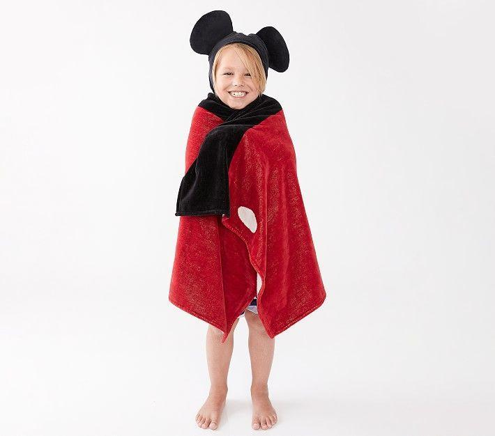 """<p><strong>pottery barn</strong></p><p>potterybarnkids.com</p><p><strong>$49.50</strong></p><p><a href=""""https://go.redirectingat.com?id=74968X1596630&url=https%3A%2F%2Fwww.potterybarnkids.com%2Fproducts%2Fdisney-mickey-mouse-kids-hooded-towel%2F&sref=https%3A%2F%2Fwww.countryliving.com%2Fshopping%2Fgifts%2Fg34122456%2Fgifts-for-disney-lovers%2F"""" rel=""""nofollow noopener"""" target=""""_blank"""" data-ylk=""""slk:Shop Now"""" class=""""link rapid-noclick-resp"""">Shop Now</a></p>"""