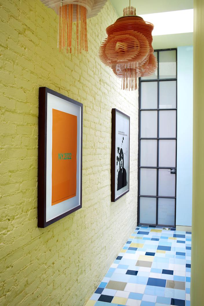 The hall displays framed posters from Pardo's 2008–2009 group show at the Guggenheim Museum in New York City.
