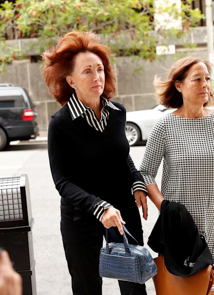 Kathleen Manafort (L), wife of former Trump campaign manager Paul Manafort, arrives prior to a pre-trial hearing for Paul Manafort ahead of his upcoming trial on a range of charges stemming from Special Counsel Robert Mueller's investigation into Russian interference in the 2016 election at U.S. District Court in Washington, U.S., September 14, 2018. REUTERS/Kevin Lamarque