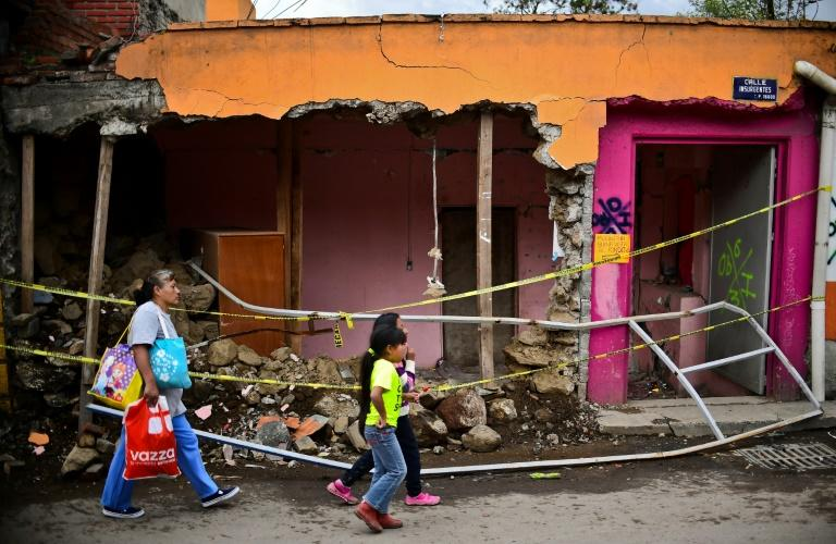 Batttered by earthquakes in September, Mexico's economy shrank in the third quarter for the first time in more than four years. This Mexico City home collapsed in the September 19 earthquake