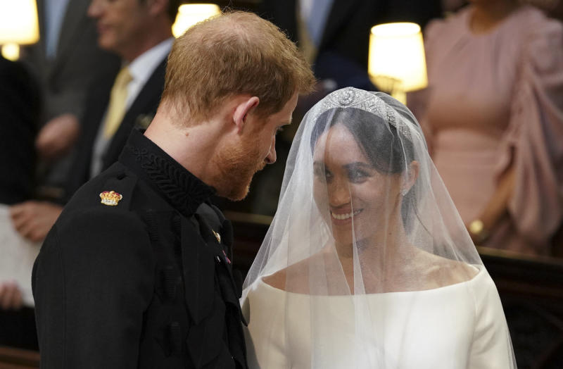 TOPSHOT - Britain's Prince Harry, Duke of Sussex (L) and US actress Meghan Markle (R) stand together at the altar in St George's Chapel, Windsor Castle, in Windsor, on May 19, 2018 during their wedding ceremony. (Photo by Dominic Lipinski / POOL / AFP) (Photo credit should read DOMINIC LIPINSKI/AFP via Getty Images)