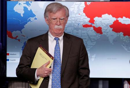 FILE PHOTO - U.S. National Security Adviser John Bolton arrives to address reporters as the Trump administration announces economic sanctions against Venezuela and the Venezuelan state owned oil company Petroleos de Venezuela (PdVSA) during a press briefing at the White House in Washington, U.S., January 28, 2019. REUTERS/Jim Young/File Picture