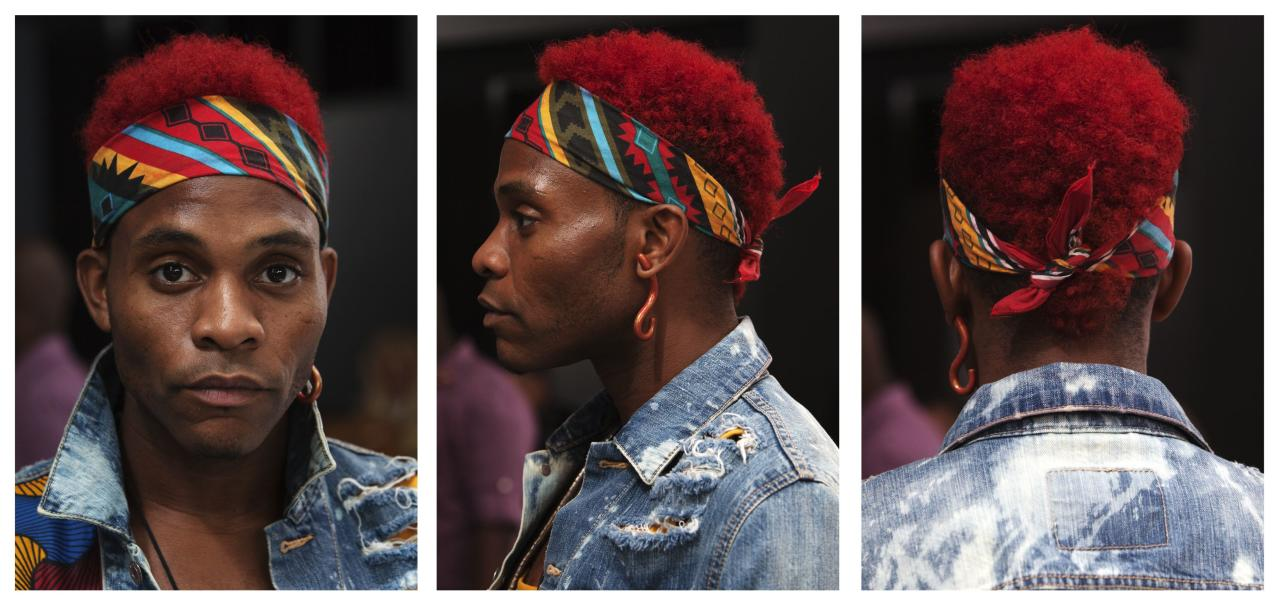 Dapper Afrika, an attendee, poses for a triptych of portraits during New York Fashion Week September 5, 2013. REUTERS/Carlo Allegri (UNITED STATES - Tags: FASHION PORTRAIT)