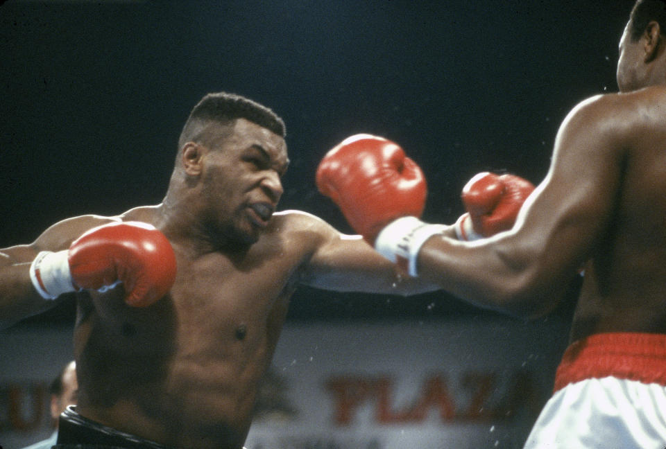 ATLANTIC CITY, NJ - JANUARY 22: Larry Holmes and Mike Tyson fights for the WBA, WBC and IBF heavyweight tittle on January 22, 1988 at the Convention Hall in Atlantic City, New Jersey. Tyson won the fight with a TKO in the 4th round. (Photo by Focus on Sport/Getty Images)