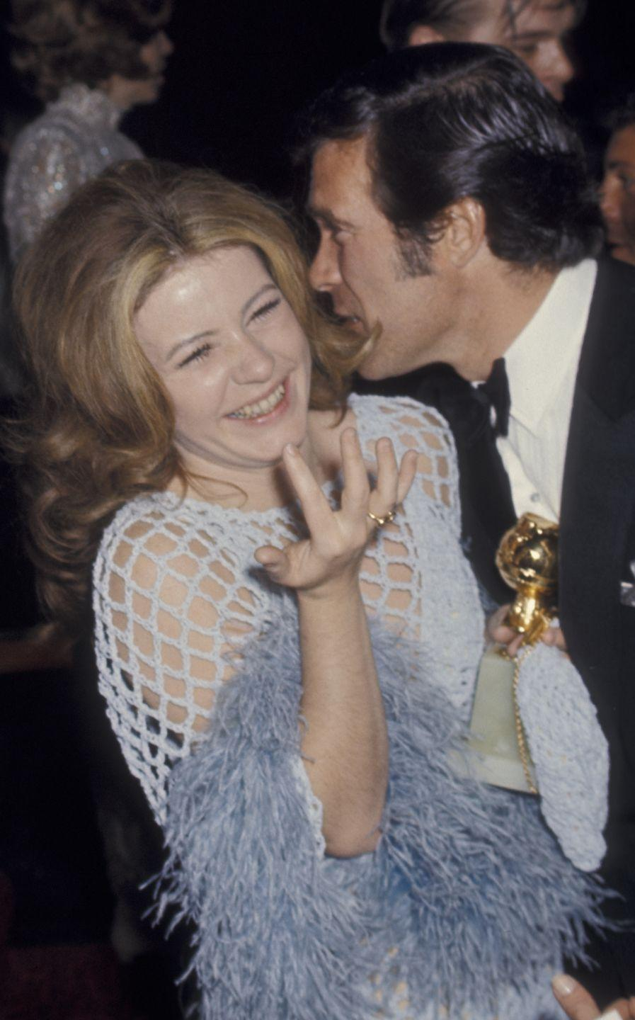 <p>Patty Duke ushered in the 1970s with a sheer netted dress and bold blue feather bell sleeves dress that was equal parts funky and fashionable. </p>