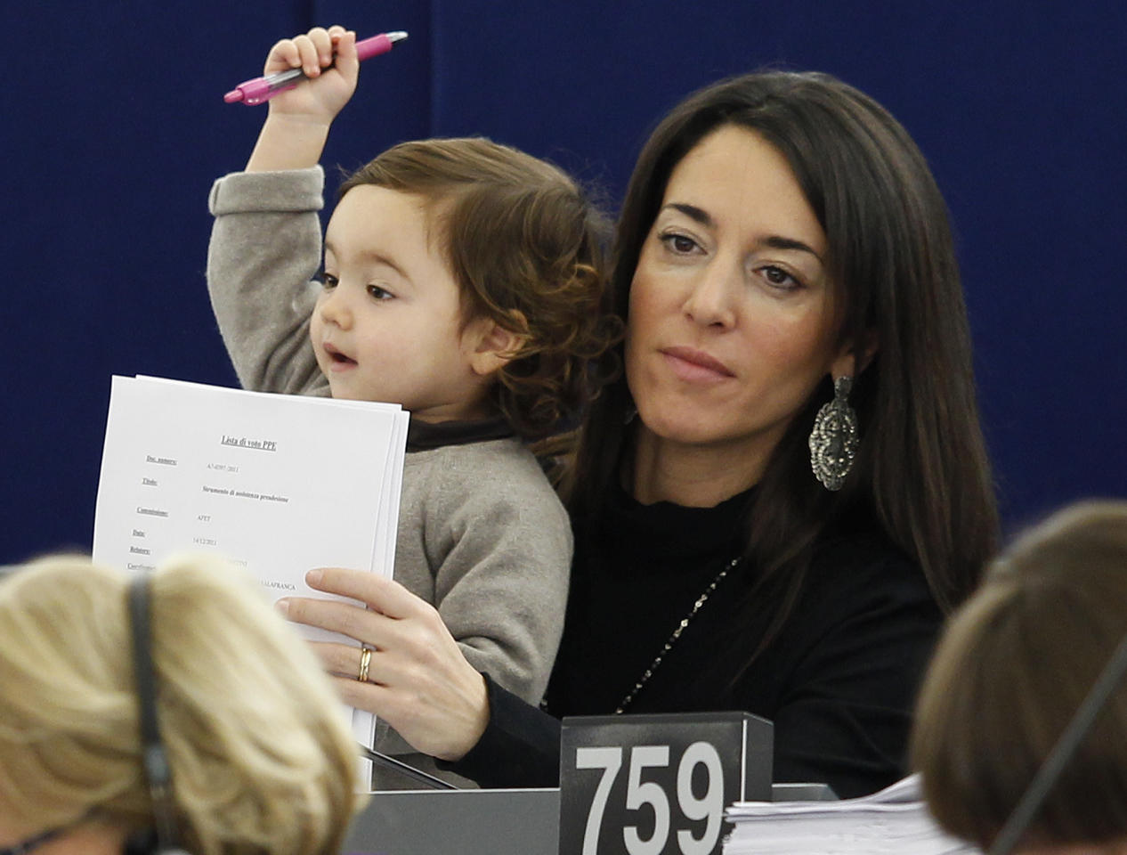 Member of the European Parliament Ronzulli of Italy holds her baby during a voting session at the European Parliament. Do you think the baby is objecting?