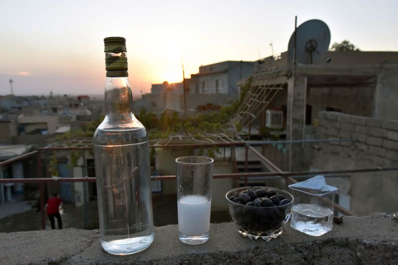 A glass of Arak produced out of dates by Saad Hussein, an Iraqi Yazidi, is pictured on the outskirts of Mosul