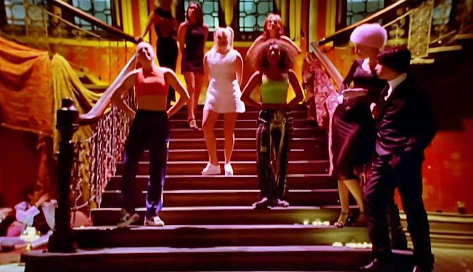 """<p>The music video for the Spice Girls' biggest hit, """"Wannabe,"""" includes a grand staircase on which the group dances along to the song. It was filmed on location in London, and it won Best Dance Video at the 1997 MTV Video Music Awards. Watch the spicy video <a href=""""https://www.youtube.com/watch?v=gJLIiF15wjQ"""" rel=""""nofollow noopener"""" target=""""_blank"""" data-ylk=""""slk:here"""" class=""""link rapid-noclick-resp"""">here</a>.</p>"""