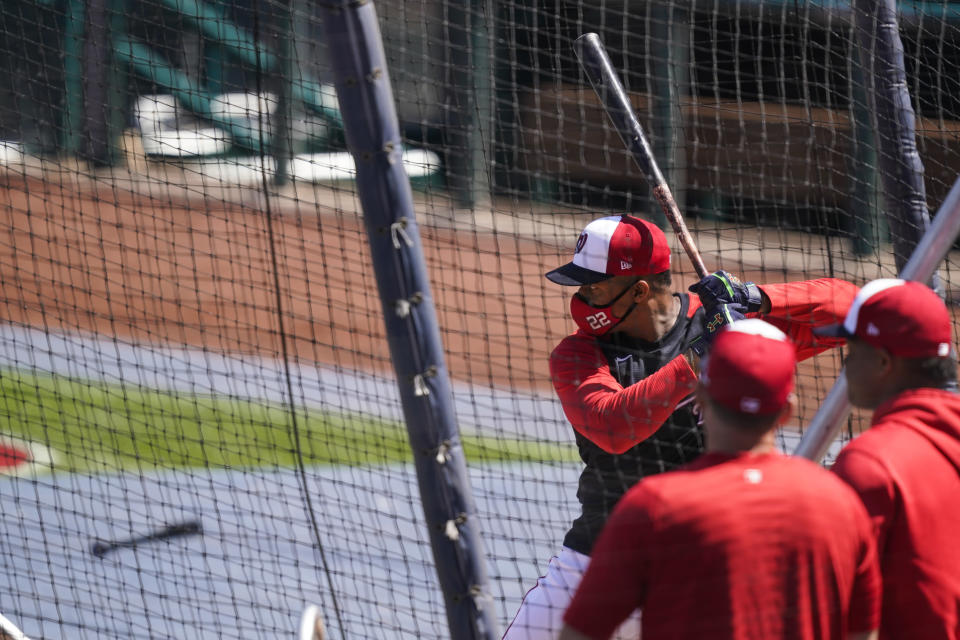 Washington Nationals' Juan Soto bats during a baseball workout at Nationals Park, Monday, April 5, 2021, in Washington. The Nationals are scheduled to play the Braves on Tuesday. (AP Photo/Alex Brandon)