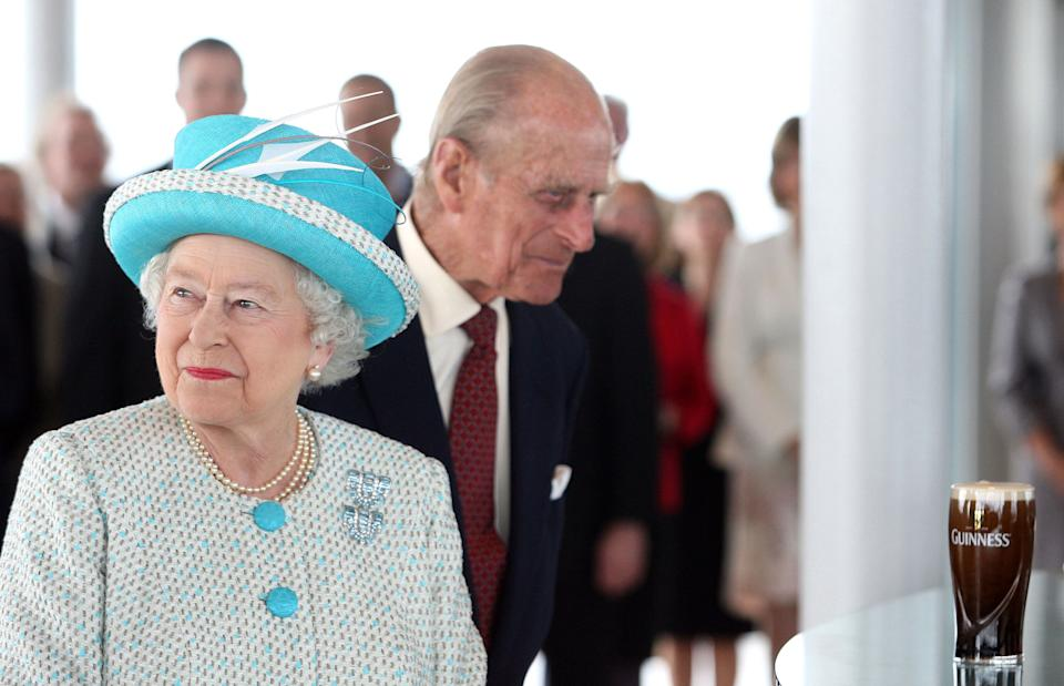 Britain's Queen Elizabeth II (L) and Prince Philip,The Duke of Edinburgh visit the Guinness Storehouse Gravity Bar in Dublin, on the second day of the Queen's four-day visit to Ireland, on May 18, 2011.Queen Elizabeth and her husband Prince Philip resisted the temptation to sup the perfect pint of Guinness on a visit to the Irish cultural icon's home brewery on Wednesday.  AFP PHOTO / Maxwells / POOL (Photo by Maxwells / POOL / AFP) (Photo by MAXWELLS/POOL/AFP via Getty Images)