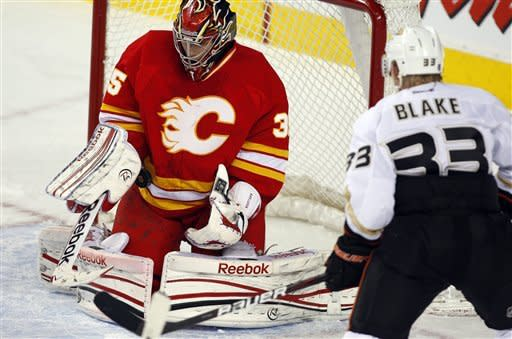 Anaheim Ducks' Jason Blake, right, looks on as Calgary Flames goalie Henrik Karlsson, from Sweden, stops his shot during second period NHL hockey action in Calgary, Alberta, Saturday, April 7, 2012. (AP Photo/The Canadian Press, Jeff McIntosh)