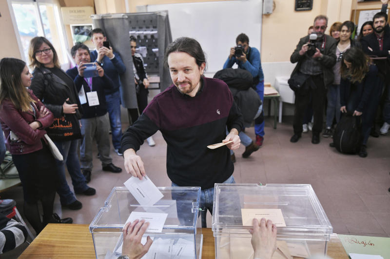 In this Podemos party handout picture, Podemos, United We Can, party leader Pablo Iglesias, casts his ballot for the general election in Madrid, Spain, Sunday, April 28, 2019. Galvanized by the Catalan crisis, Spain's far right is set to enter Parliament for the first time in decades while the Socialist government tries to cling on to power in Spain's third election in four years. (AP Photo/Podemos via AP)