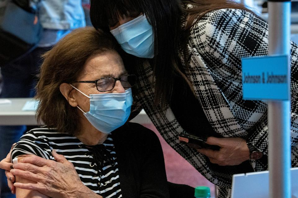 86-year-old Barbara Schmalenberger, of Hilliard, Ohio, hugs her daughter, Melanie Gagnon, after receiving the Johnson & Johnson coronavirus disease (COVID-19) vaccine at the OSU Wexner Medical Center in Columbus, Ohio, U.S. March 2, 2021.