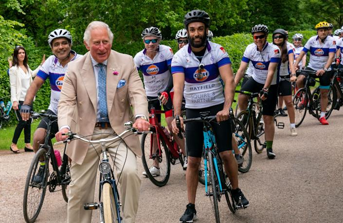 The Prince of Wales cycles with representatives of the British Asian Trust at Highgrove in Gloucestershire before they embark on the charity's 'Palaces on Wheels' cycling event. Picture date: Thursday June 10, 2021.