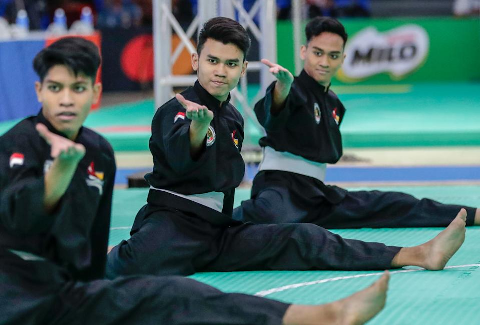 Singapore silat athletes (from left) Kamal Nazrul, Hamillatu Arash and Nujaid Hasif clinch a SEA Games gold medal in the men's seni regu (artistic team) event in Subic. (PHOTO: Sport Singapore)