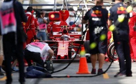 Formula One - F1 - Australian Grand Prix - Melbourne, Australia - 24/03/2017 Ferrari driver Kimi Raikkonen from Finland sits in the pits during the first practice session. REUTERS/Brandon Malone