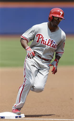 Philadelphia Phillies' Jimmy Rollins runs the bases after hitting a home run during the first inning of a baseball game against the New York Mets Saturday, July 20, 2013, in New York. (AP Photo/Frank Franklin II)