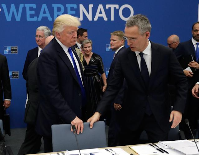 <p>NATO Secretary General Jens Stoltenberg (R) and US President Donald Trump take a seat during a working dinner meeting at the NATO (North Atlantic Treaty Organization) headquarters in Brussels on May 25, 2017 during a NATO summit. (Matt Dunham/AFP/Getty Images) </p>