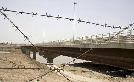 A view of a bridge to Afghanistan across Panj river in Panji Poyon border outpost, south of Dushanbe, Tajikistan, May 31, 2008. REUTERS/Shamil Zhumatov/File Photo