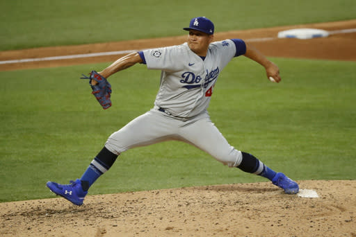 Los Angeles Dodgers relief pitcher Victor Gonzalez throws a pitch during the fifth inning of a baseball game against the Texas Rangers in Arlington, Texas, Sunday, Aug. 30, 2020. (AP Photo/Roger Steinman)