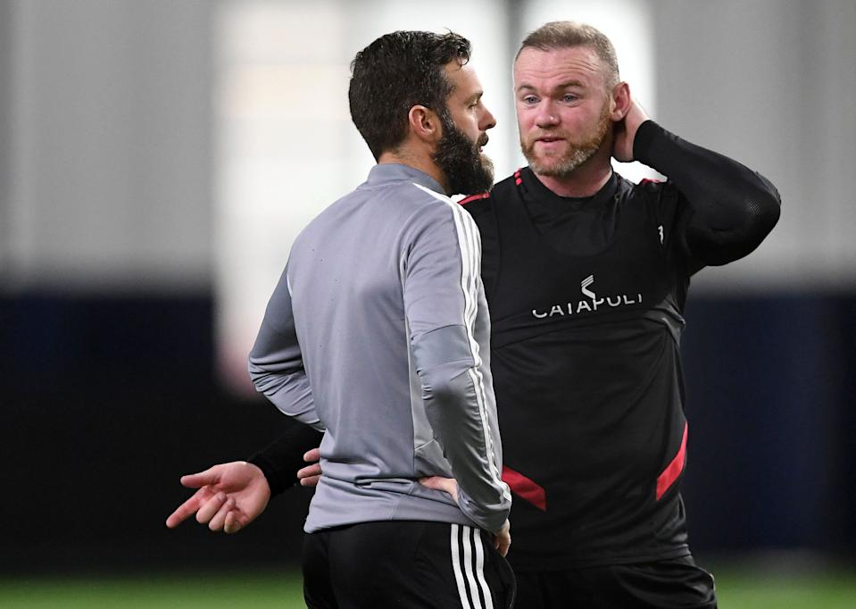 STERLING, VA - JANUARY 23:  D.C. United head coach Ben Olsen talks with forward Wayne Rooney (9) during the team's media day practice at The St. James on Wednesday, January 23, 2019.  (Photo by Toni L. Sandys/The Washington Post via Getty Images)