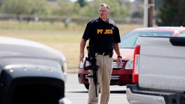 PHOTO: A law enforcement officer stands in the middle of the 5100 block of E. 42nd Street in Odessa, Texas, Aug. 31, 2019, following a shooting. (Mark Rogers//Odessa American via AP)