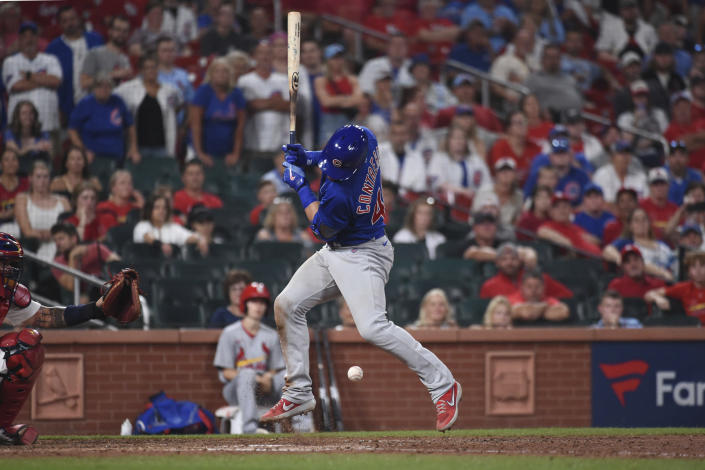 Chicago Cubs' Willson Contreras is hit by a pitch during the ninth inning of the team's baseball game against the St. Louis Cardinals on Wednesday, July 21, 2021, in St. Louis. (AP Photo/Joe Puetz)