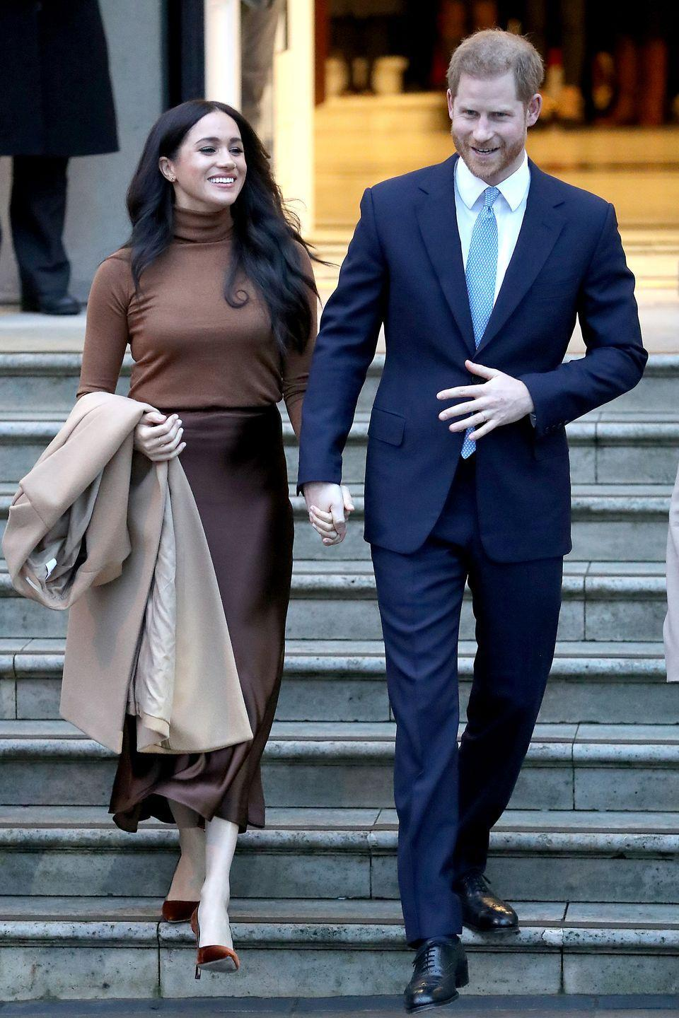 <p>The couple holds hands as they depart Canada House in London.</p>