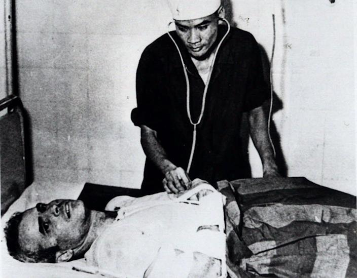 John McCain with medical personnel