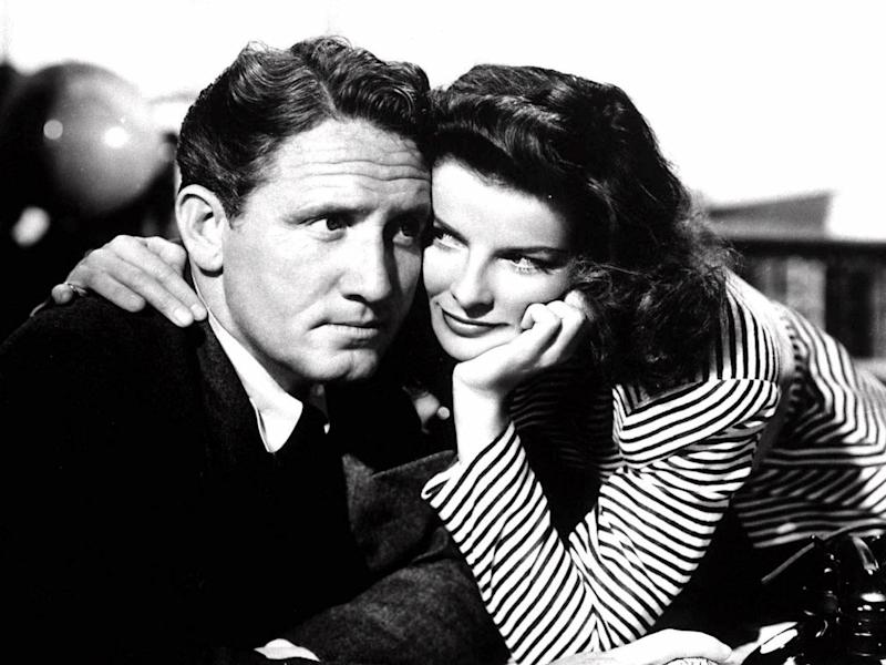 "Spencer Tracy and Katharine Hepburn as Sam Craig and Tess Harding in scene from movie ""Woman of the Year"", B&W photo"