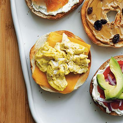 """<p>Skip the drive-thru and make delicious egg-and-cheese <a href=""""https://www.myrecipes.com/menus/8-mind-blowingy-delicious-ways-to-top-a-bagel-that-go-beyond-cream-cheese"""" rel=""""nofollow noopener"""" target=""""_blank"""" data-ylk=""""slk:bagels"""" class=""""link rapid-noclick-resp"""">bagels</a> at home with this simple recipe. Using reduced-fat cheddar cheese helps cut fat and calories as well. </p>"""