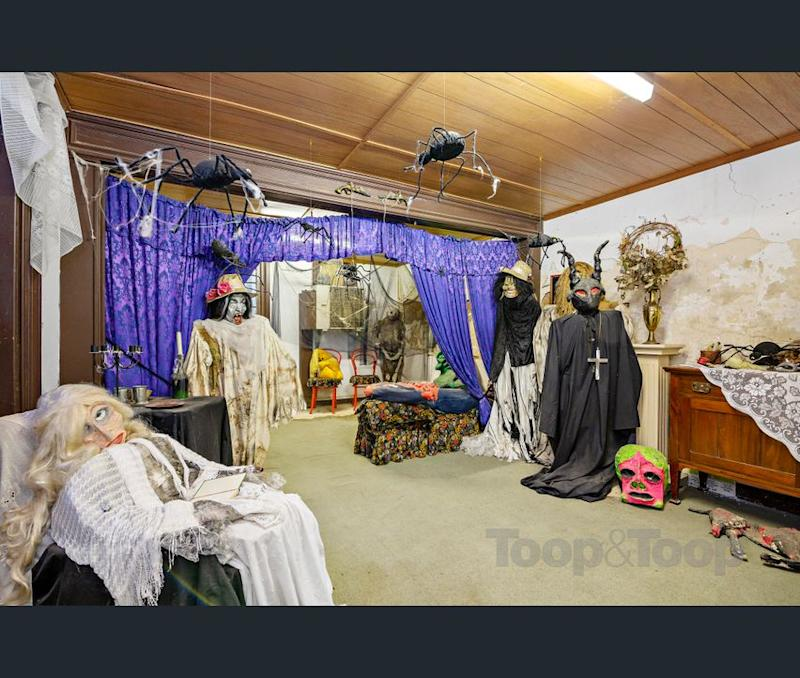 Creepy decorations in the cellar of the Macgill house for sale. (Image: realestate.com.au/Toop & Toop)