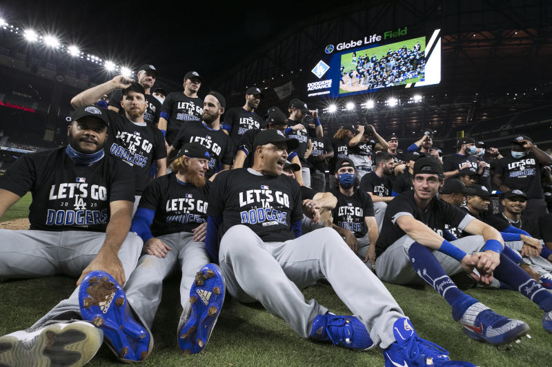 ARLINGTON, TX - OCTOBER 08: The Los Angeles Dodgers celebrate with a team photo on the field after a 12-3 win in Game 3 of the NLDS between the Los Angeles Dodgers and the San Diego Padres at Globe Life Field on Thursday, October 8, 2020 in Arlington, Texas. (Photo by Kelly Gavin/MLB Photos via Getty Images)