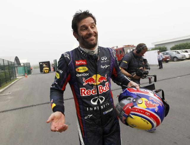 Red Bull Formula One driver Mark Webber of Australia reacts as he returns to the garage area after he retired from the race during the Indian F1 Grand Prix at the Buddh International Circuit in Greater Noida, on the outskirts of New Delhi, October 27, 2013. REUTERS/Adnan Abidi (INDIA - Tags: SPORT MOTORSPORT F1 TPX IMAGES OF THE DAY)