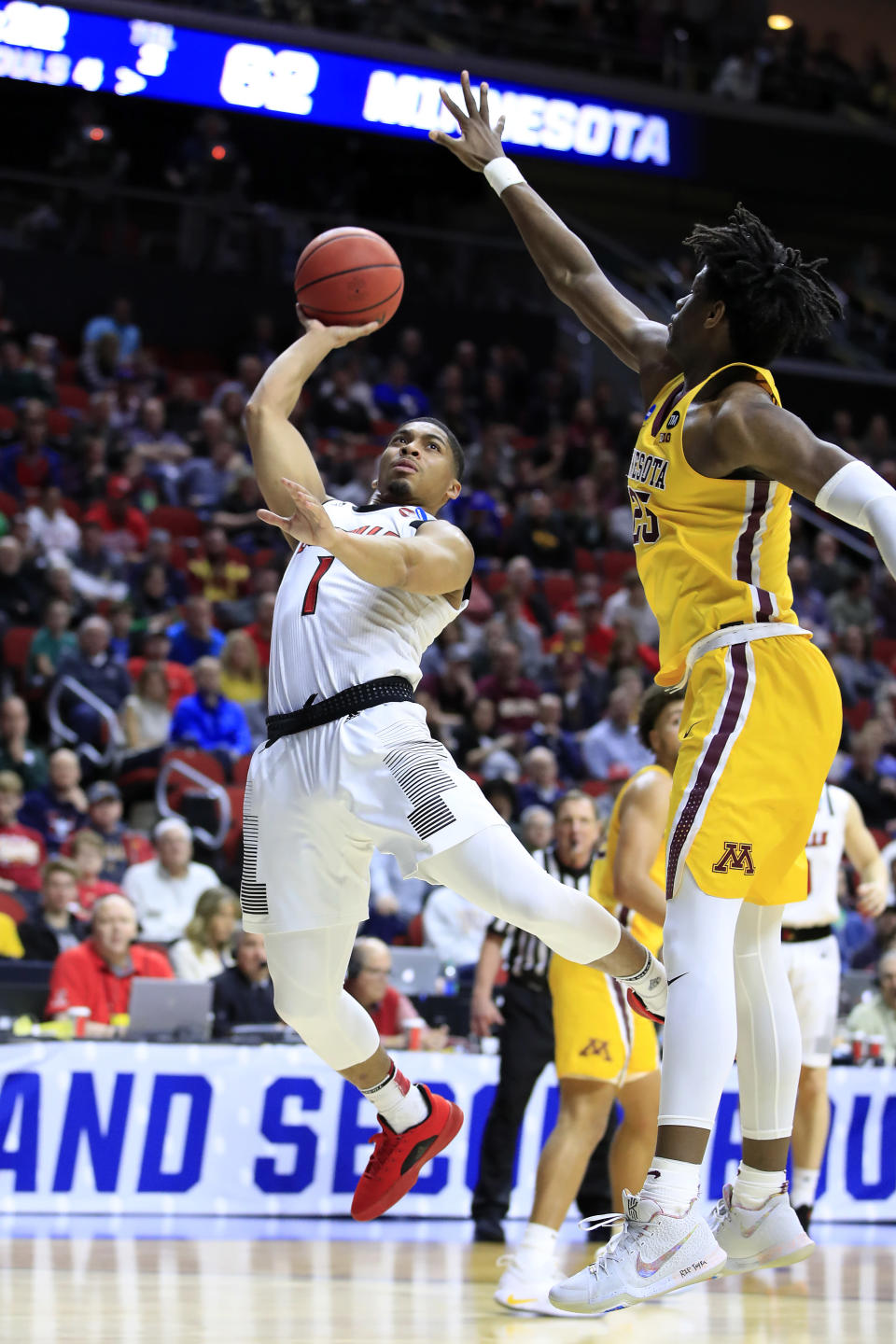 <p>Christen Cunningham #1 of the Louisville Cardinals takes a shot against Daniel Oturu #25 of the Minnesota Golden Gophers during their game in the First Round of the NCAA Basketball Tournament at Wells Fargo Arena on March 21, 2019 in Des Moines, Iowa. (Photo by Andy Lyons/Getty Images) </p>