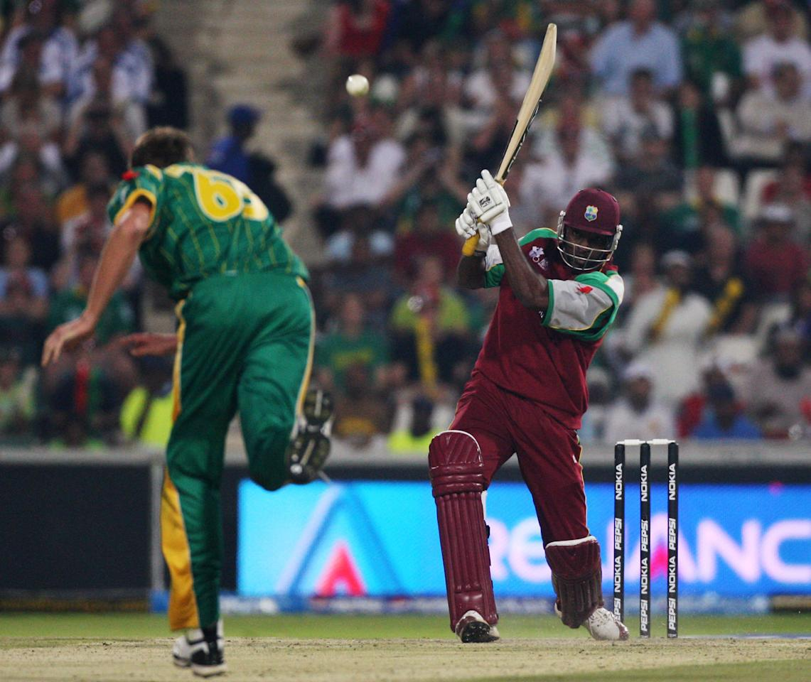 JOHANNESBURG, SOUTH AFRICA - SEPTEMBER 11: Chris Gayle of West Indies hit out at the bowling of Graeme Smith of South Africa, at The Wanderers Cricket Ground during The ICC World Twenty20 Championship match between West Indies and South Africa on September 11, 2007 in Johannesburg, South Africa. (Photo by Julian Herbert/Getty Images)